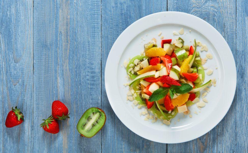 Fruit salad closeup, vegan food.